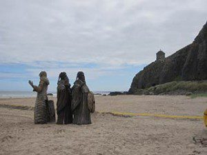 Game of Thrones film location Downhill Northern Ireland 'old gods' sculpture on the beach under Mussenden Temple