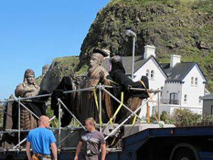 Game of Thrones film location Downhill Northern Ireland lifting one of the 'old gods' sculptures